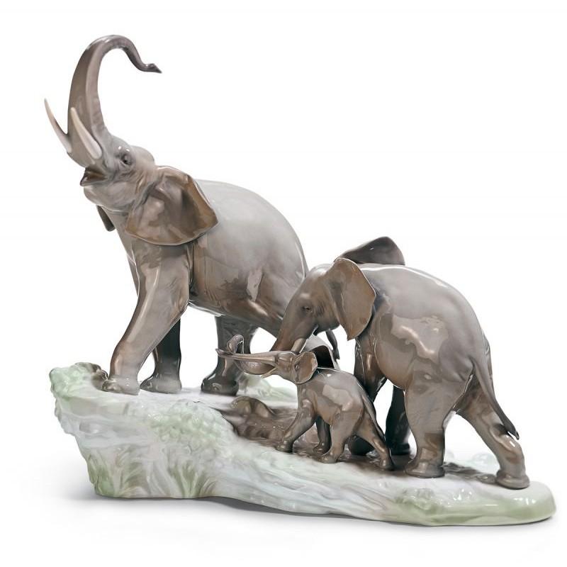 Elephants Walking Figurine