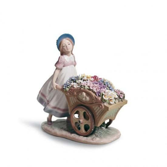 Figura de porcelana de Lladró Con flores al mercado