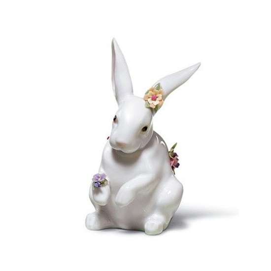 Sitting bunny with flowers