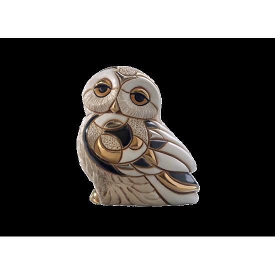 Figurine en céramique d'un hibou des neiges