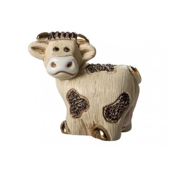 Figura de cerámica de una vaca