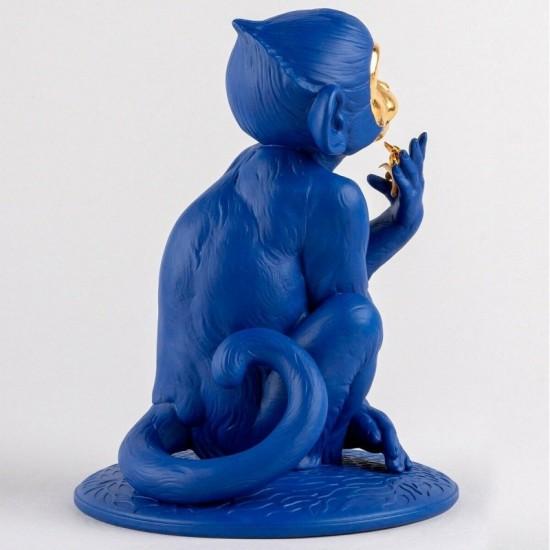Figura de porcelana Lladró de un mono azul-dorado