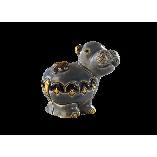 Figure en céramique d'un hippopotame.