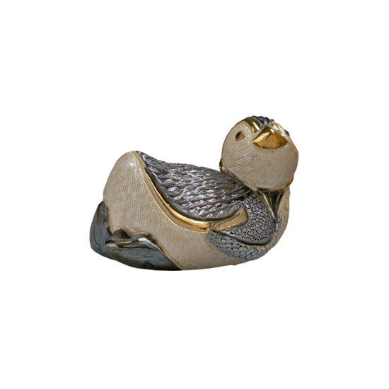 Sliding penguin. Ceramic figure